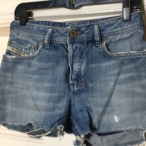 Distressed cut off diesel shorts